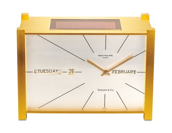 """An attractive and well preserved gilt brass solar powered perpetual calendar table clock with """"straight line"""" display, retailed by Tiffany & Co."""