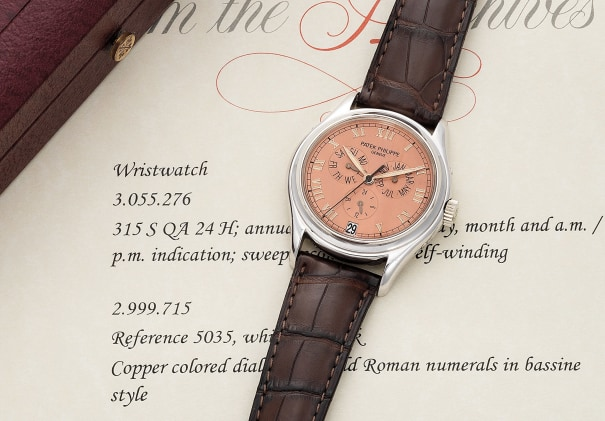 A very fine and attractive white gold annual calendar wristwatch with copper colored dial and extract from the archives