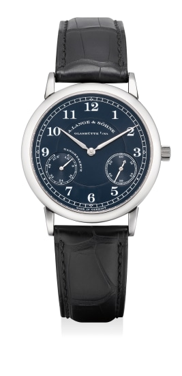 An attractive white gold wristwatch with power reserve and blue dial