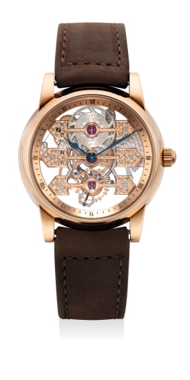 A rare, extremely fine and unusual pink gold wristwatch with tourbillon regulator and three gold bridges movement