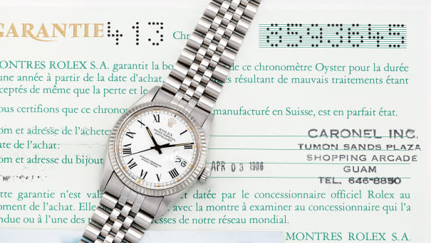 A fine stainless steel and white gold wristwatch with center seconds, date, bracelet and guarantee