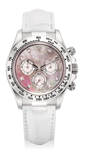 A fine and rare white gold, meteorite, mother-of-pearl and diamond-set chronograph wristwatch with guarantee and box