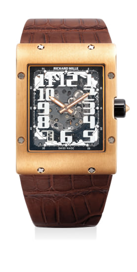 A large, fine and attractive pink gold rectangular skeletonized wristwatch with date, variable geometry rotor, warranty and box