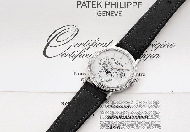 A very fine and rare white gold perpetual calendar wristwatch with moon phases, 24-hour indication, hobnail bezel, certificate and box