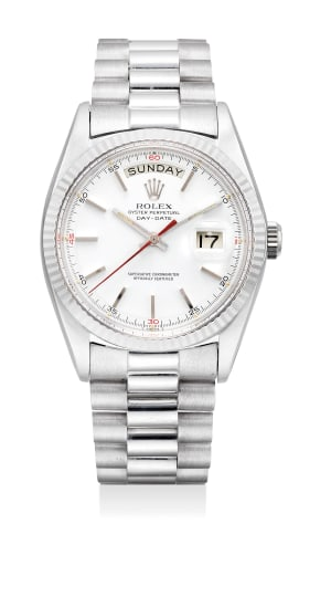 An very fine white gold wristwatch with day, date, sweep center seconds, bracelet and fitted presentation box