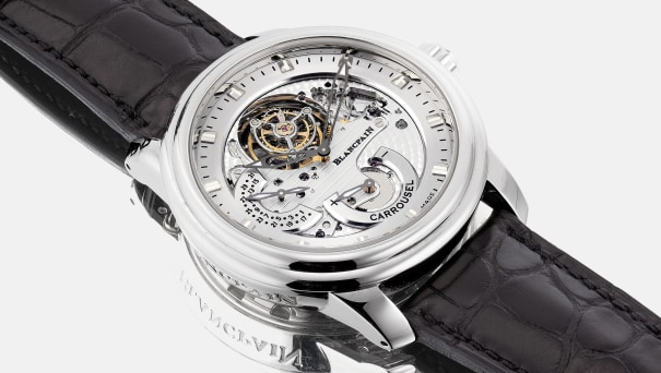 A very fine and rare platinum semi-skeletonized wristwatch with tourbillon regulator, power reserve, date, certificate and box, numbered 68 of a limited edition of 288 pieces