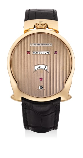 A very fine and extremely unusual pink gold asymmetrical wristwatch with jump hours, digital minutes, linear triple calendar and moon phases
