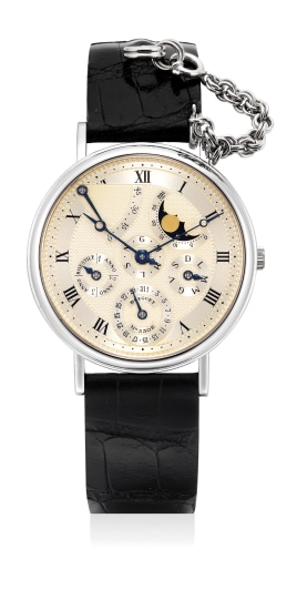 A fine and attractive white gold perpetual calendar wristwatch with moon phases, leap year indication and power reserve
