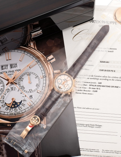A very fine and attractive pink gold perpetual calendar split-second chronograph wristwatch with moon phases, day/night indication, certificate of origin and fitted presentation box, single sealed