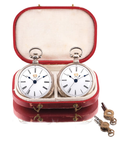 A very fine and rare matching pair of silver openface pocket watches with center seconds and original fitted presentation case and winding keys