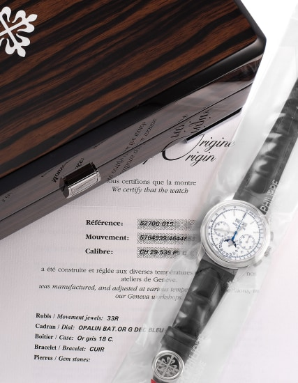 An extremely fine and rare limited edition perpetual calendar chronograph wristwatch with white dial, blued seconds hand, certificate of origin, additional solid case back, and presentation box, single sealed.