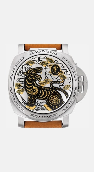 An attractive and rare limited edition stainless steel and inlaid gold wristwatch with date and concealed dial made for the year of the tiger, presentation box and international guarantee