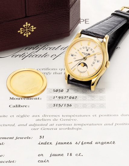 A rare, very elegant and exceptionally fine yellow gold perpetual calendar wristwatch with center seconds, moonphases, retrograde date, certificate and box