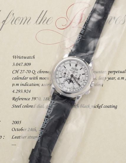 A very fine and attractive white gold perpetual calendar chronograph wristwatch with moon phases