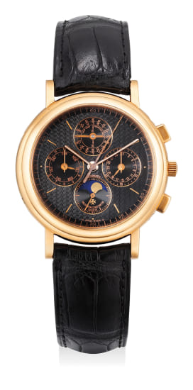 A fine and very attractive pink gold perpetual calendar chronograph wristwatch with moon phase and black dial