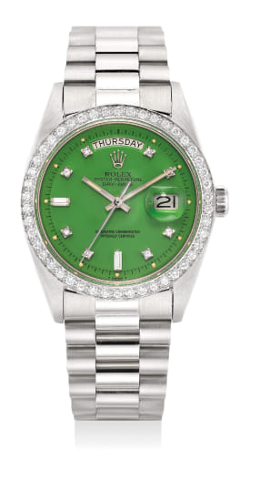 """A very fine and rare white gold and diamond set wristwatch with green """"Stella"""" dial, day, date, center seconds, bracelet and service guarantee"""