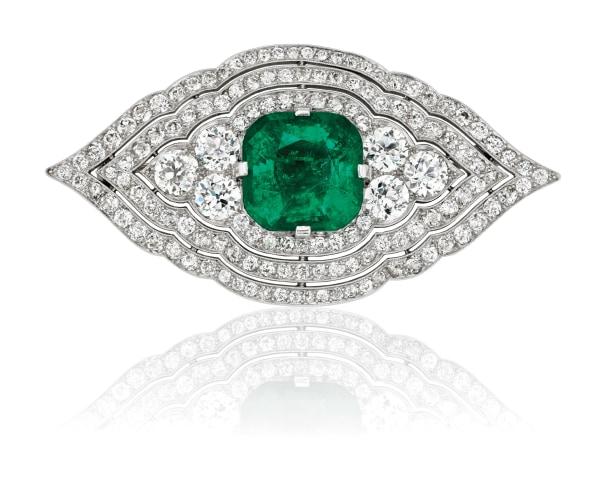 An Art Deco Emerald, Diamond and Platinum Brooch