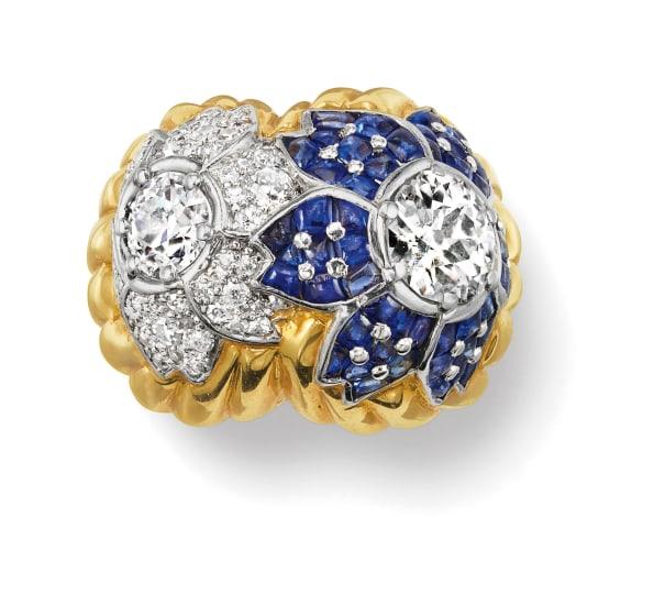 A Diamond, Sapphire, Gold and Platinum Ring