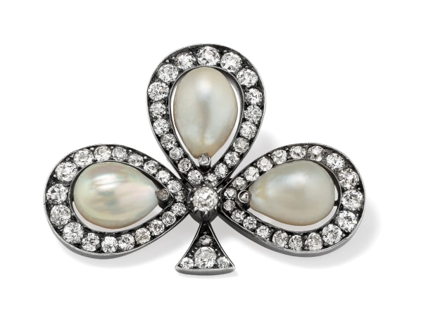 An Antique Natural Pearl, Diamond and Silver Topped Gold Brooch