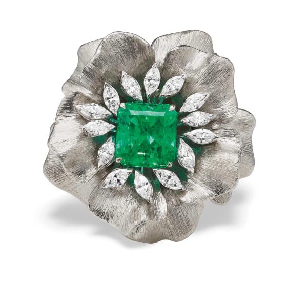 An Emerald, Diamond, Titanium and Gold Ring