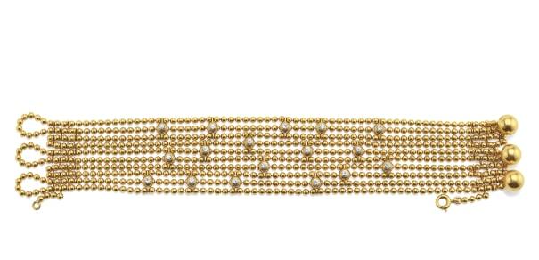 A Diamond and Gold 'Draperie de Decollete' Bracelet