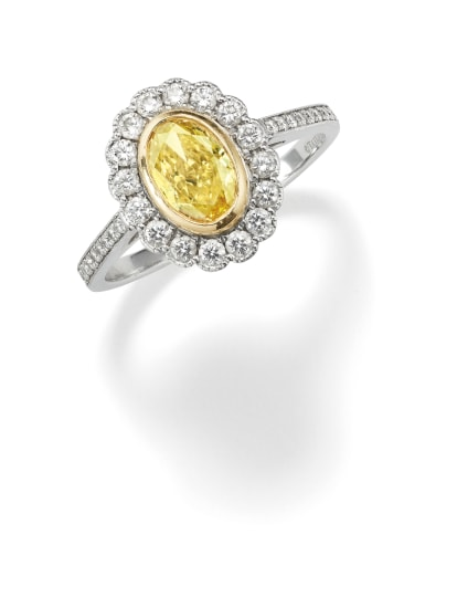 A Fancy Intense Diamond, Diamond, Platinum and Gold Ring