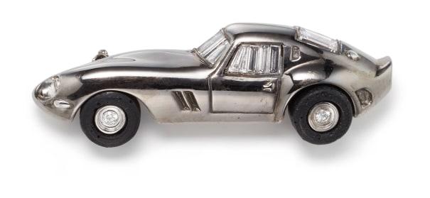 A Diamond and Gold 'Ferrari' Brooch