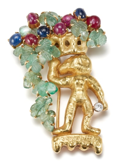 An Emerald, Ruby, Star Ruby, Sapphire, Diamond and Gold Brooch