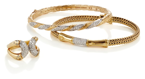 A Diamond and Gold Ring and Set of Bracelets