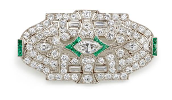An Art Deco Diamond, Emerald and Platinum Brooch