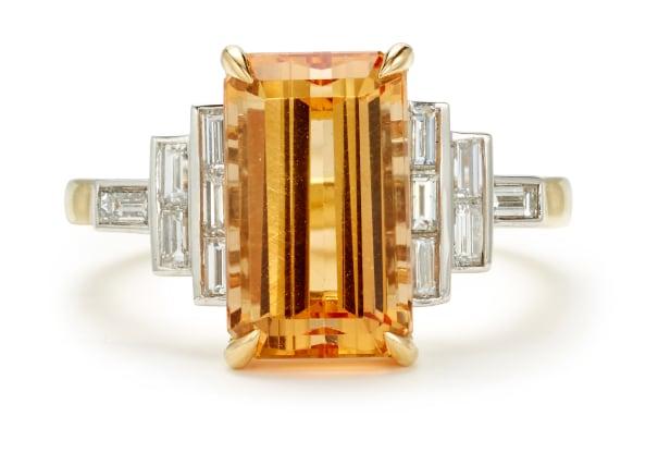 A Topaz, Diamond, Gold and Platinum Ring