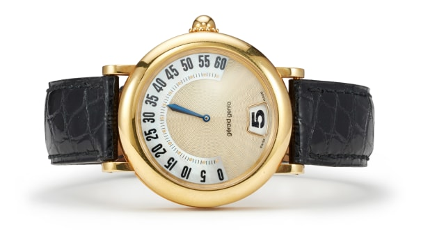A Gold and Leather Wristwatch