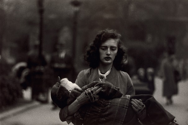 Woman carrying a child in Central Park, N.Y.C.