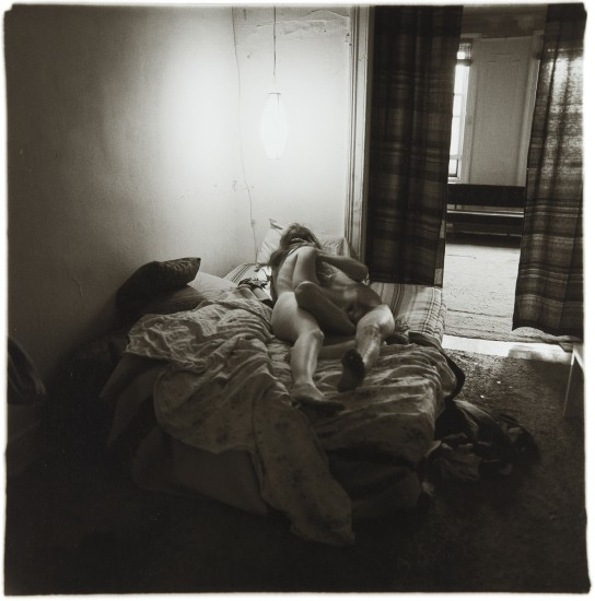 Couple in bed under paper lantern, N.Y.C.