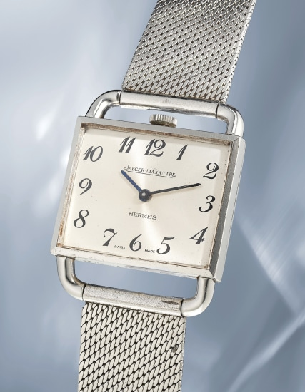 An unusual and elegant stainless steel squared shaped wristwatch with bracelet