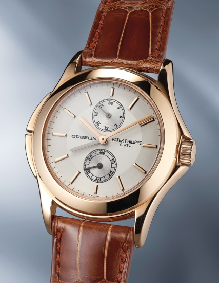 A rare and attractive limited edition pink gold travel time wristwatch with certificate of origin and presentation box