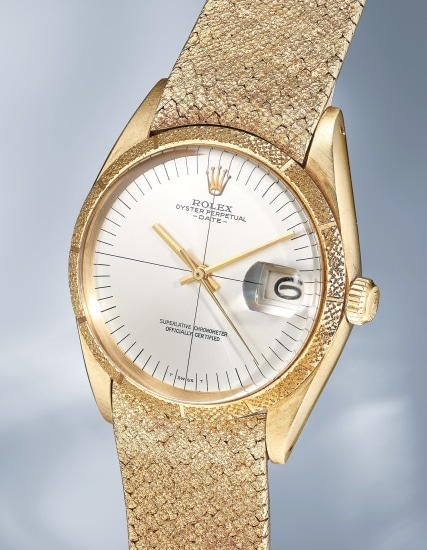 A striking, unusual and extremely rare yellow gold wristwatch with center seconds, date, bracelet and guarantee