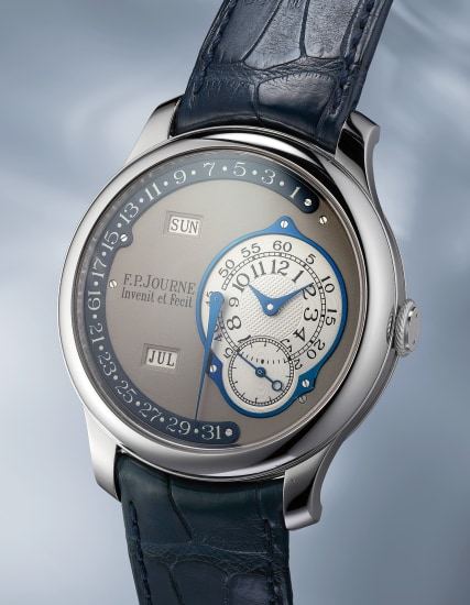 A unique and attractive platinum annual calendar wristwatch with retrograde date made for John Asprey