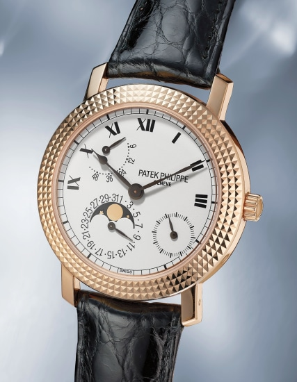 A rare and fine limited edition pink gold wristwatch with date, power reserve and moonphases