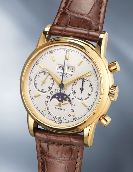 A very fine and rare yellow gold perpetual calendar chronograph wristwatch with moonphases and original certificate