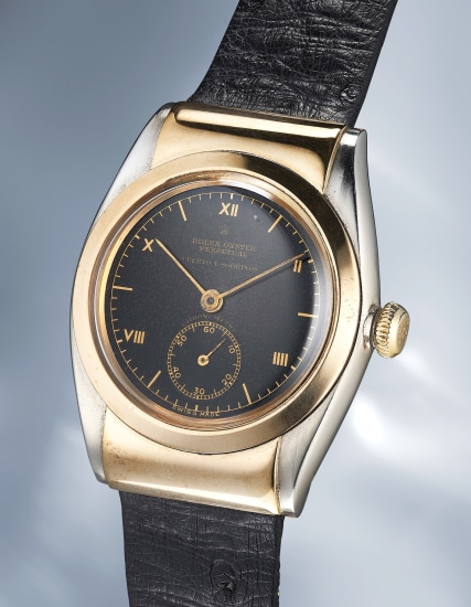 A remarkable, impressive and extremely rare yellow gold and stainless steel wristwatch with black dial