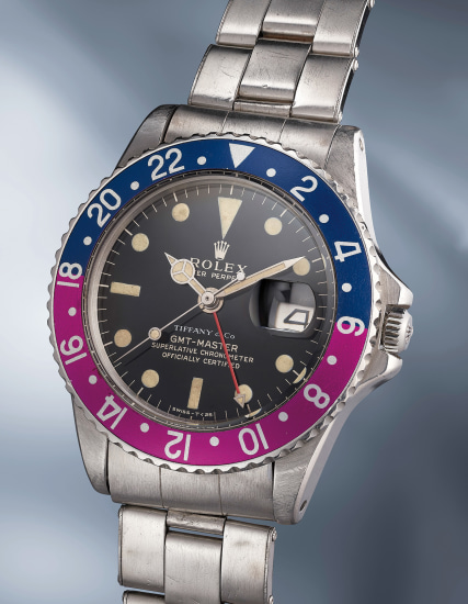 A striking and extremely rare stainless steel automatic dual time wristwatch with center seconds, date, gilt/gloss dial, fuchsia bezel and bracelet