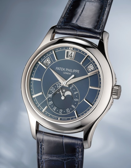 A highly rare and attractive limited edition white gold instantaneous annual calendar wristwatch with blue dial, certificate of origin, portfolio and fitted presentation box