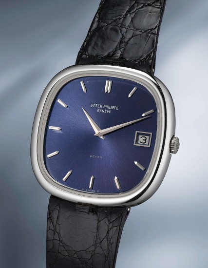 A very elegant and masculine cushion-shaped white gold wristwatch with blue dial, box and original guarantee