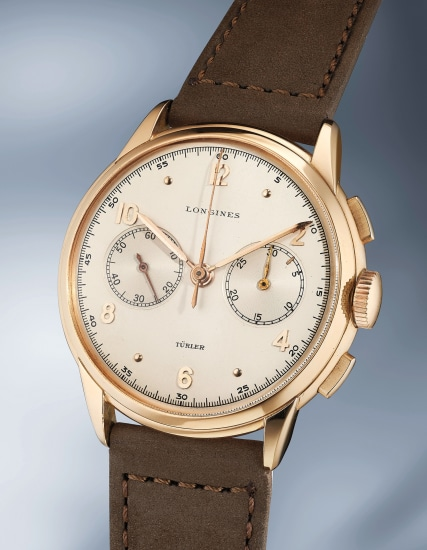 An extremely rare, large and elegant pink gold chronograph wristwatch
