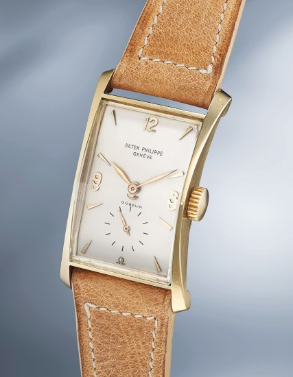 An unusual and attractive yellow gold rectangular wristwatch with faceted crystal