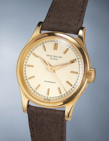 A highly rare and attractive yellow gold wristwatch with center seconds, luminous markers and hands