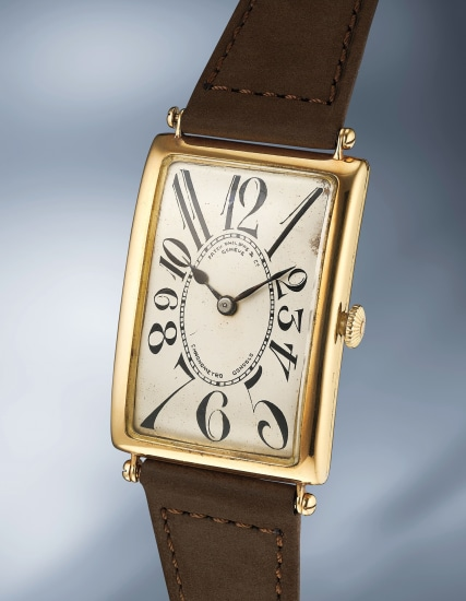 """An impressive oversized yellow gold wristwatch with """"exploding"""" numerals"""
