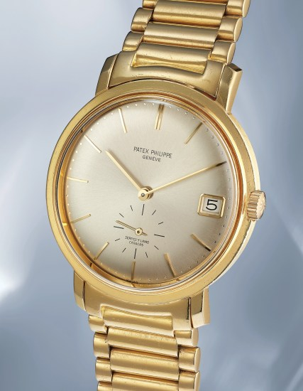 A very rare and imposing yellow gold wristwatch with date and bracelet