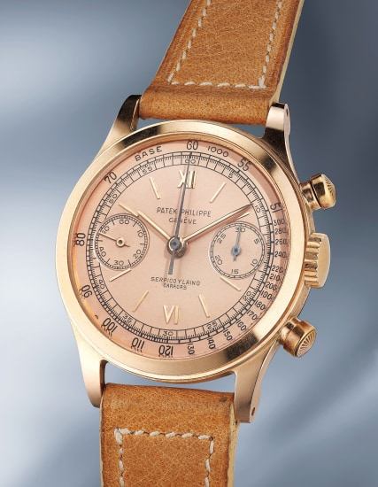 An incredibly attractive and rare pink gold chronograph wristwatch with pink dial